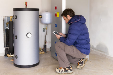 a man checking a water heater