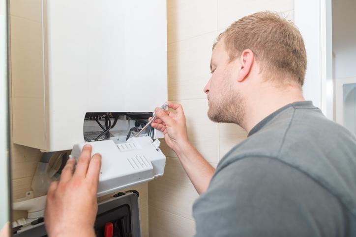 Man inspecting water heater