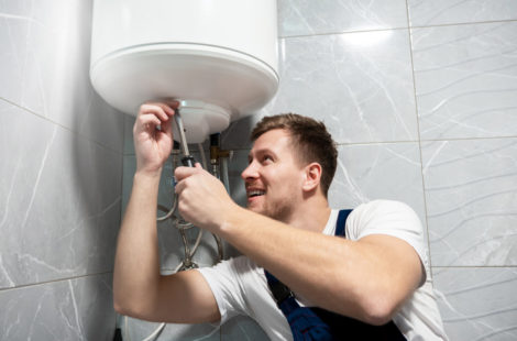Man fixing water heater