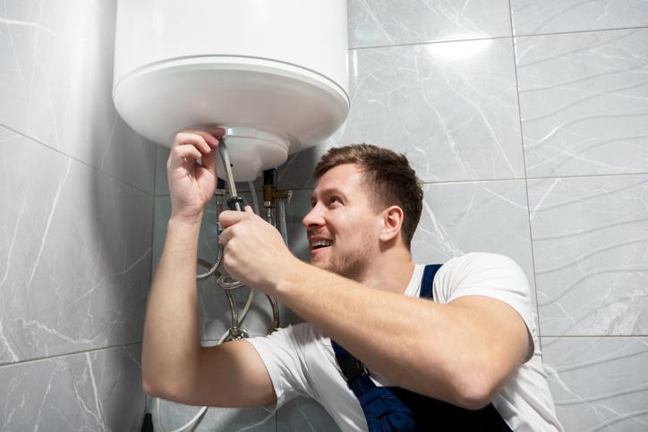 Man fixing water heater