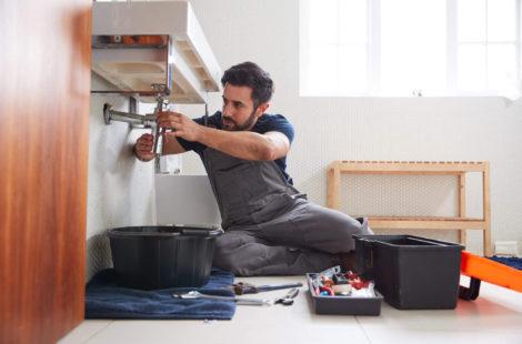 Man fixing under sink
